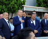 Erdoğan, havalimanındaki taksicileri ziyaret etti